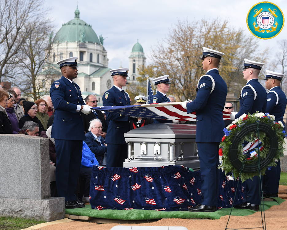 November 2, 2019 - The U.S. Coast Guard Ceremonial Honor Guard begins the flag-folding ceremony as part of the full military honors burial for Lt. Thomas Crotty, a USCG POW, in Buffalo, New York. Crotty was taken prisoner following the defense of the Philippines in World War II and later died in a Japanese prisoner of war camp. His remains were recently identified by the Defense POW/MIA Accounting Agency. (Image created by USA Patriotism! from U.S. Coast Guard photo by Petty Officer 3rd Class Brian McCrum)