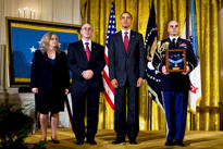 President Barack Obama stands with Phil and Maureen Miller, parents of U.S. Army Staff Sgt. Robert J. Miller, as the citation is read as part of the ceremony to posthumously award the Medal of Honor to their son in the East Room of the White House, Oct. 6, 2010. Miller was cited for heroic actions in Afghanistan on Jan. 25, 2008. White House photo by Pete Souza