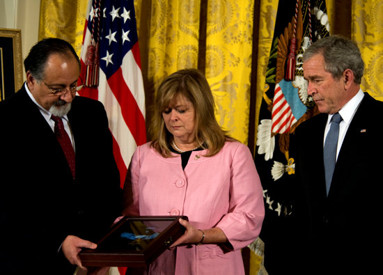 (April 8, 2008) President George W. Bush presents the Medal of Honor to George and Sally Monsoor Tuesday, April 8, 2008 during a ceremony in the East Room of the White House for the actions of their son during combat in Iraq. Master-at-Arms 2nd Class (Seal) Michael A. Monsoor has been posthumously awarded the Medal of Honor for diving onto a grenade to save his teammates in Ar Ramadi, Iraq on Sept. 29, 2006. Monsoor also received the Silver Star for his actions in May during the same deployment in 2006 when he exposed himself to heavy enemy fire to rescue and treat an injured teammate.