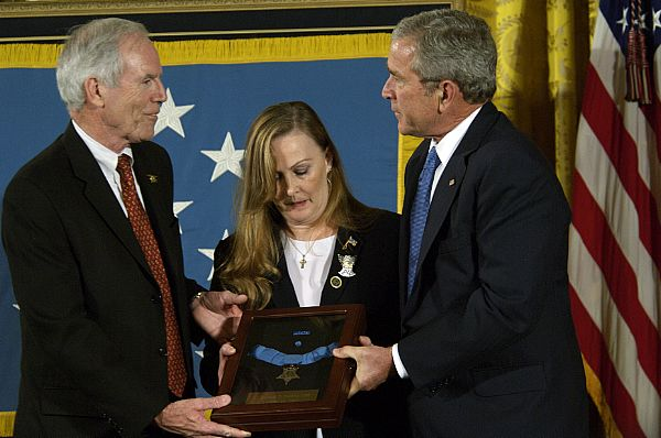 President George W. Bush presents the Medal of Honor to Daniel and Maureen Murphy, the parents of Navy SEAL Lt. Michael Murphy, during a ceremony at the White House. Lt. Murphy was killed during a reconnaissance mission near Asadabad, Afghanistan, while exposing himself to enemy fire in order to call in support after his four-man team came under attack by enemy forces June 28, 2005. Murphy is the first service member to receive the honor for actions during Operation Enduring Freedom and the first Navy recipient of the medal since Vietnam.