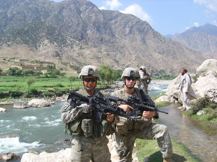 Sgt. Ryan Pitts and Sgt. Israel Garcia patrol the area near the village of Rechalam, Afghanistan, which is west of Forward Operating Base Blessing, in the summer of 2007. (U.S. Army courtesy photo)