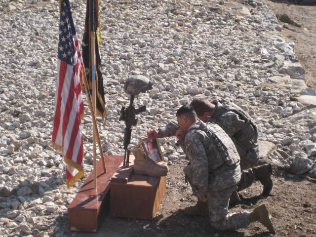 Staff Sgt. Lucas Gonzalez and Sgt. Ryan Pitts pay their respects to former platoon sergeant Sgt. 1st Class Matthew Kahler, during a memorial ceremony at Combat Outpost Bella, Afghanistan, January 28, 2008. Kahler was killed during a patrol to visit guard stations near COP Bella. (U.S. Army courtesy photo)