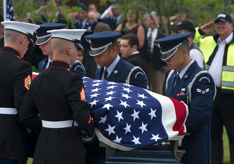 "August 1, 2013 - Pallbearers, made up of Airmen and Marines, carry the casket of retired U.S. Air Force Col. George ""Bud"" Day during his funeral service at Barrancas National Cemetery on Naval Air Station Pensacola, Florida. Day, a Medal of Honor recipient and combat pilot with service in World War II, Korea and Vietnam, passed away July 27, 2013 at the age of 88. (U.S. Air Force photo by Staff Sgt. John Bainter)"