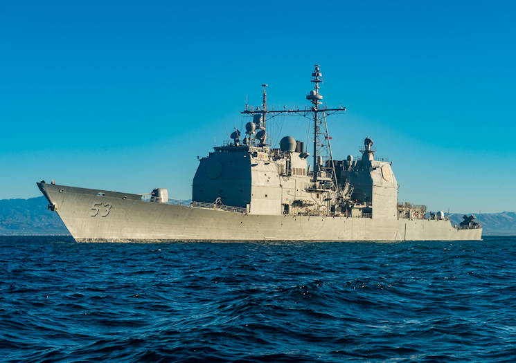 October 22, 2017 - The guided-missile cruiser USS Mobile Bay (CG 53) sails past Port Hueneme, Calif. after the successful transport of passengers and equipment to and from the ship. Mobile Bay is currently underway testing the updated AEGIS Baseline 9 weapons system in preparation for its upcoming deployment. (U.S Navy Photo by Mass Communication Specialist 1st Class Chad M. Butler)