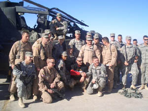 Aaron in Iraq with troops in front of chopper (2005)