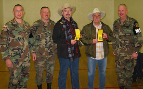 With troops by their side, Bellamy Brothers being presented with a special medallion during 2004 South Korean tour.
