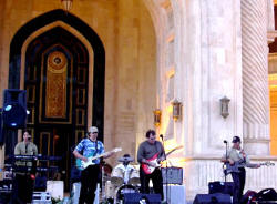 Joe and the guys perform on the steps of Saddam's Baghdad, Iraq Palace, renamed Camp Victory by the American Forces.