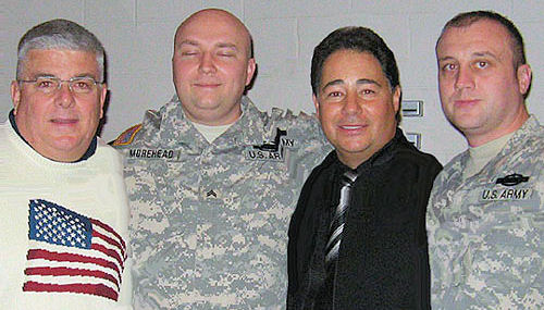 "Daniel Rodriguez and friend with two soldiers at a ""Concert for the Troops"""
