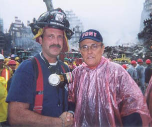Vincent Forras shaking hands with Mayor Rudi Giuliani at WTC in aftemath of 9/11/01.