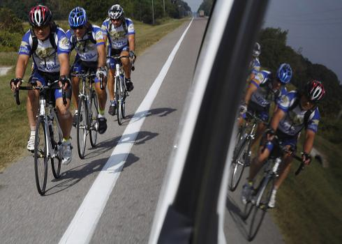 Members of the SEALs Bike America team ride along State Road 47 in northern Florida during an 88-mile leg of their cross-country trek on Nov. 2, 2010. Retired and former U.S. Navy SEALs and professional cycling champion Marty Jemison began the SEALs Bike America journey in Coronado, Calif. in late September and are scheduled to complete the 3,300-mile ride Nov. 6 at the National Navy Underwater Demolition Team-SEAL Museum in Ft. Pierce, Fla. U.S. Navy photo by Mass Communication Specialist 2nd Class Andrew Breese