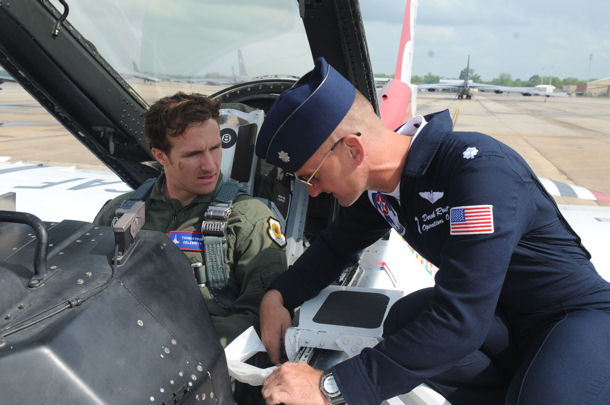 Lt. Col. Derek Routt describes the features of the F-16 Fighting Falcon to New Orleans Saints quarterback Drew Brees prior to an orientation flight April 23, 2010, at Barksdale Air Force Base, La. Lieutenant Routt is the operations officer for the Air Force Air Demonstration Squadron, the Thunderbirds.