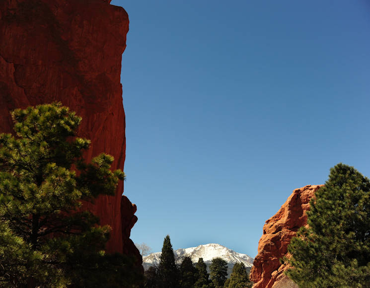 April 7, 2016 -  Pike's Peak, known as America's Mountain, is visible through the natural window between the rock formations known as the Twins in Colorado's Garden of the Gods. Spanning 1,367 acres of terrain ranging from scrub lands to high tundra, the garden is one of the most heavily photographed sites in the Colorado Springs area.(U.S. Air Force photo by Staff Sgt. Amber Grimm)