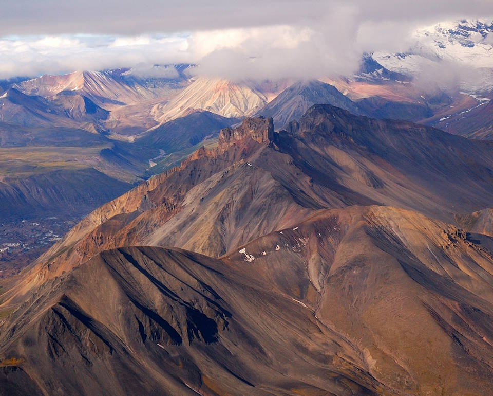 Stunning view of the Northern section of the Wrangell Mountains that are a high mountain range in eastern Alaska with much of it in Wrangell-Saint Elias National Park and Preserve. (Image created by USA Patriotism! from U.S. National Park Service photo by Bryan Petrtyl.)
